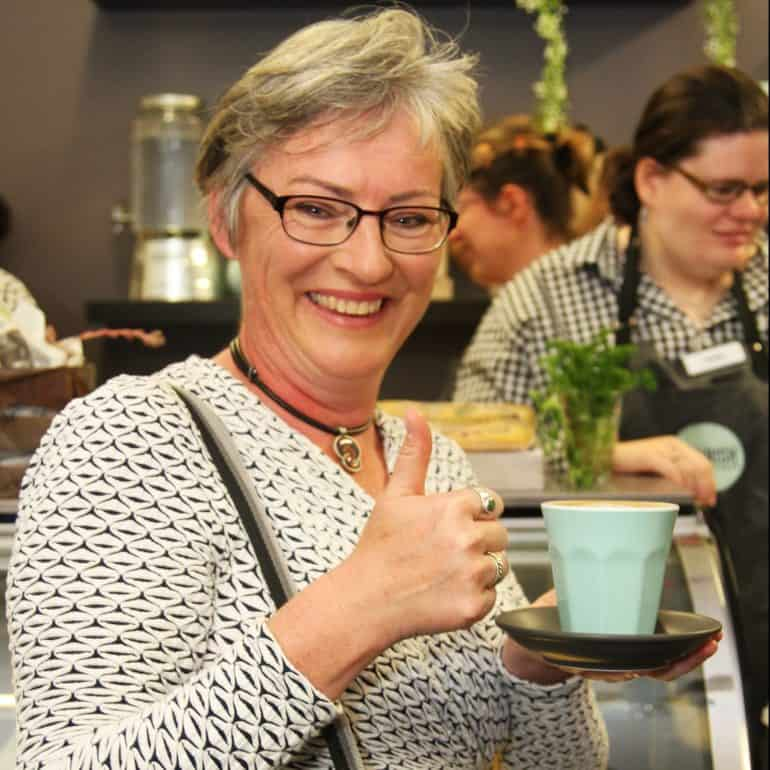 Customer enjoying a cup of coffee atCivic Kitchen & Catering Nowra