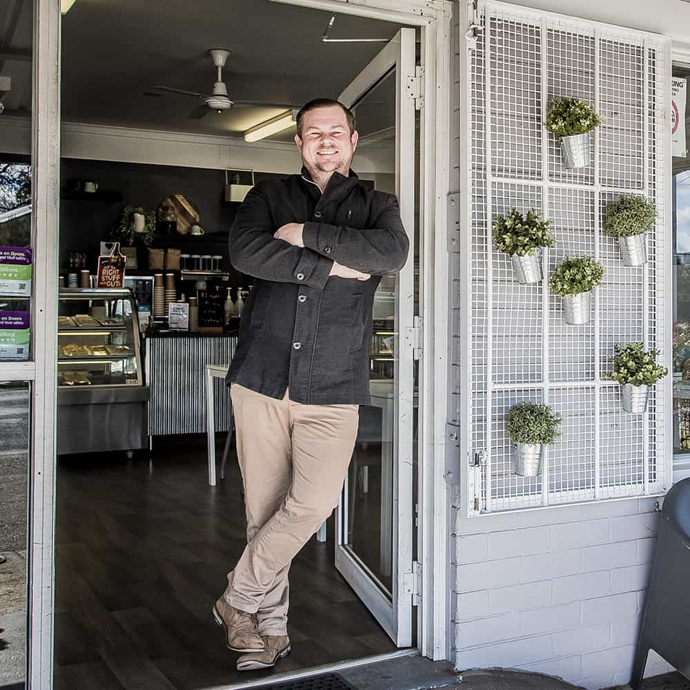 Civic Kitchen & Catering cafe owner posing in cafe door