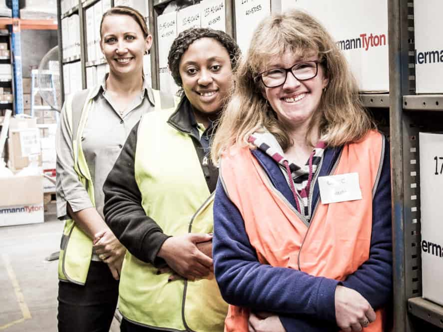 Civic Warehousing and Mailing staff posing for a picture dressed in their high vis vests