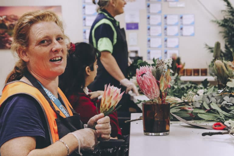 Civic crew hard at work arranging flowers with the Ring O' Roses social enterprise