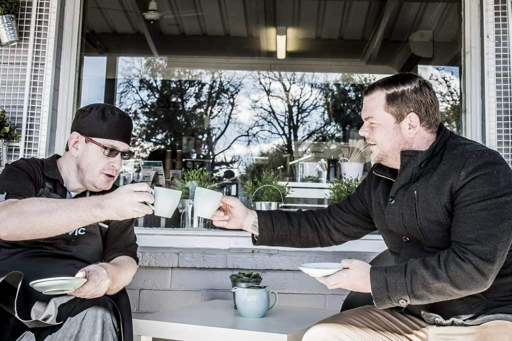 staff member enjoying a coffee with a client at Civic Café Nowra