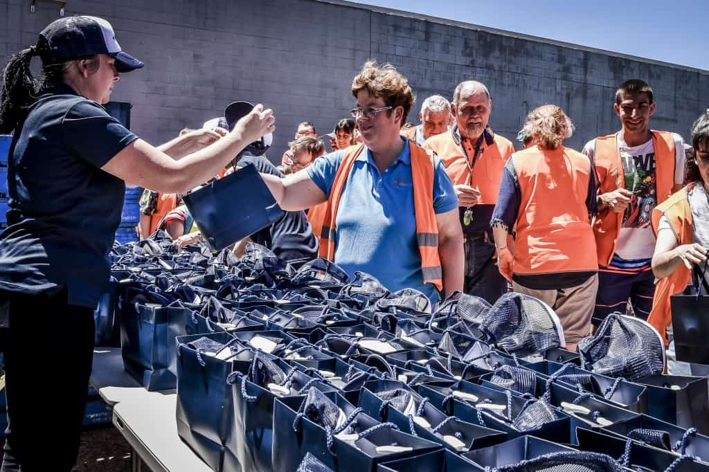 Civic crew receiving True Blue kit bags