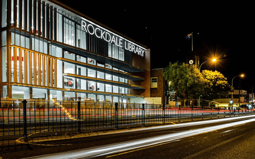 An outside view of Rockdale Library at night