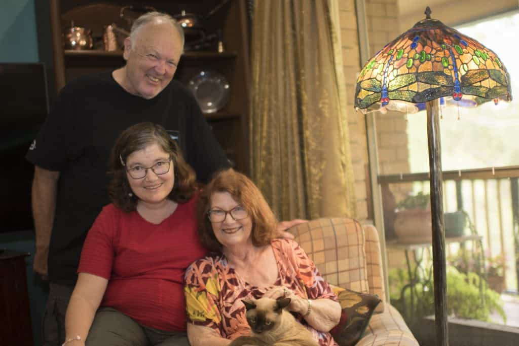 Civic disability accommodation client, Felicity (middle) with her Dad, Bob (top) and Mum, Robin (right)