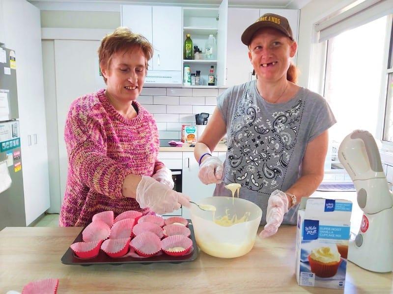 Civic clients baking cupcakes