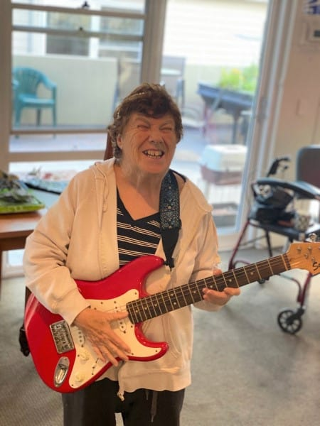 Civic client playing electric guitar