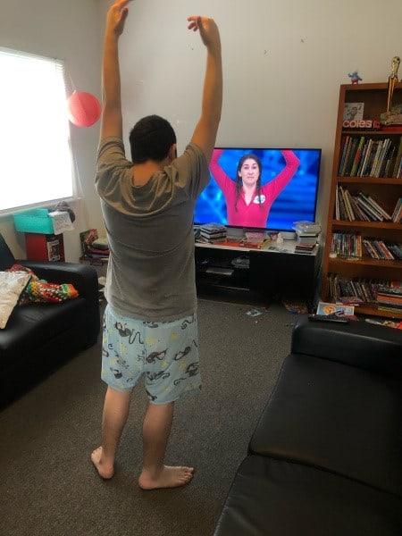 Rhys following an online Yoga routine.