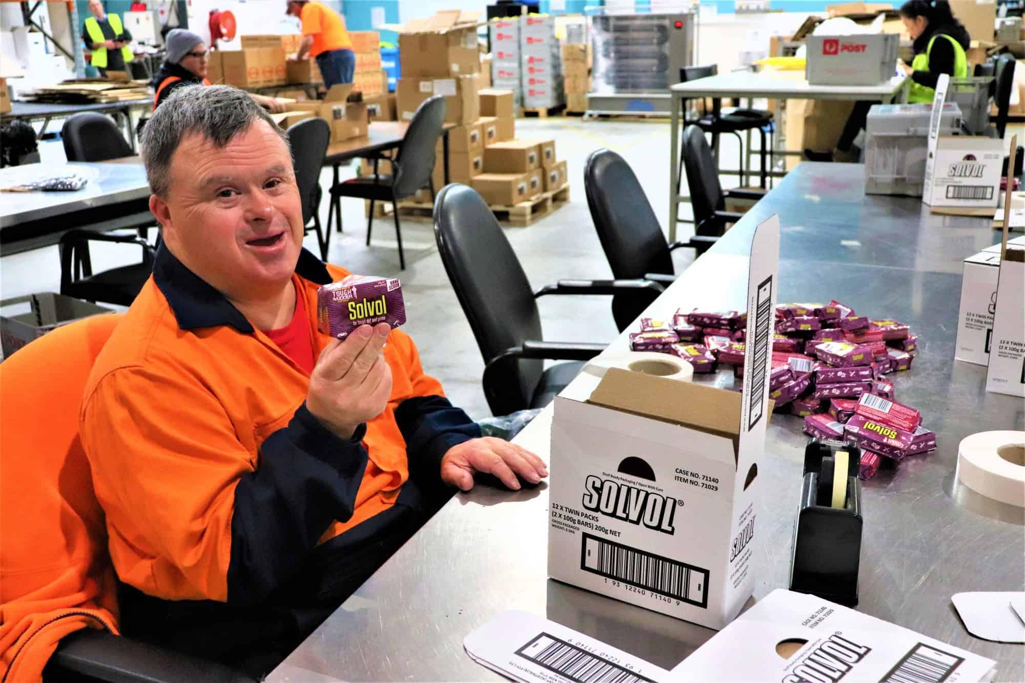 Civic crew member packing Solvol soap